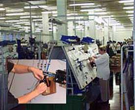 Workers assemble electrical products at a KWL plant.