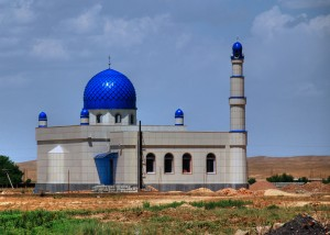 A new mosque rises in the Kyrgyz landscape.  Photo by Irene2005. Creative Commons licensed.