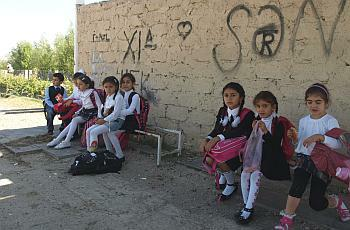 Azeri children wait for the school bus in front of School No. 3 in Gardabani.