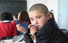 Kyrgyz schoolboy. Photo by Ben Paarmann. Creative Commons licensed.
