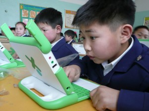 A Mongolian student tries out an OLPC laptop. Photo by Carla Gomez.