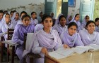 The UK government is committed to getting two million more girls into school in Pakistan by 2015. UK aid has already helped more than 590,000 girls in Khyber Pakhtunkhwa stay in school over the last few years by giving them small cash stipends. Each girl receives 200 rupees (about £1.50) a month, and a set of free textbooks each year to help them get an education. With an average family size of up to seven or eight and a third of the population living on less than $1 a day, these small stipends and free text books can make the difference between daughters being sent to school or having to drop out.  This photo is attributed to Vicki Francis of the UK Department for International Development and has been licensed under the Creative Commons Attribution-Share Alike 2.0 Generic License.