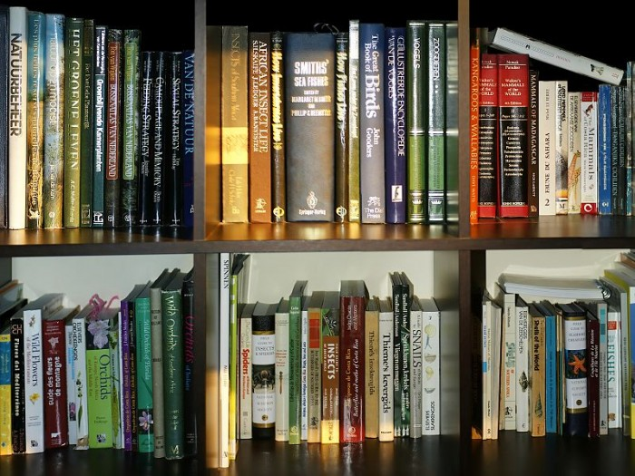 Nature related books on a bookshelf. This image is attributed to Hans Hillewaert and is licensed under the Creative Commons Attribution-Share ALike 3.0 Unported license.
