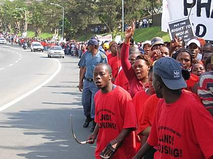 A protest by the Durban shack dwellers' organisation Abahlali baseMjondolo. This image is attributed to Inkani, who as the copyright holder of the work has them self released it into the public domain.