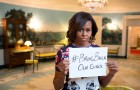 """First Lady Michelle Obama holding a sign with the hashtag """"#bringbackourgirls"""" in support of the 2014 Chibok kidnapping. Posted to the FLOTUS Twitter account on May 7, 2014.  This image is in the public domain in the United States because it is a work prepared by an officer or employee of the United States Government as part of that person's official duties under the terms of Title 17, Chapter 1, Section 105 of the US Code. Image contributed by Masem."""