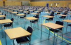 Tables and chairs ready for students's final exam at Norwegian University of Science and Technology in Trondheim, Norway.  This image is attributed to Milford, who has released for use into the public domain.